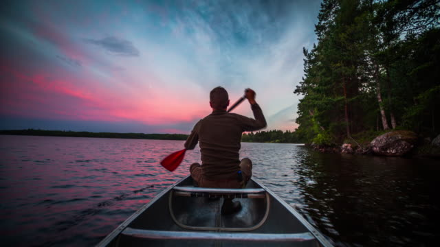 canoeing at sunset - small boat stock videos & royalty-free footage