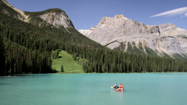 canoeing in emerald lake, yoho national park, canada - banff stock videos & royalty-free footage