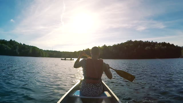 canoeing in sweden slow motion - canoe stock videos & royalty-free footage