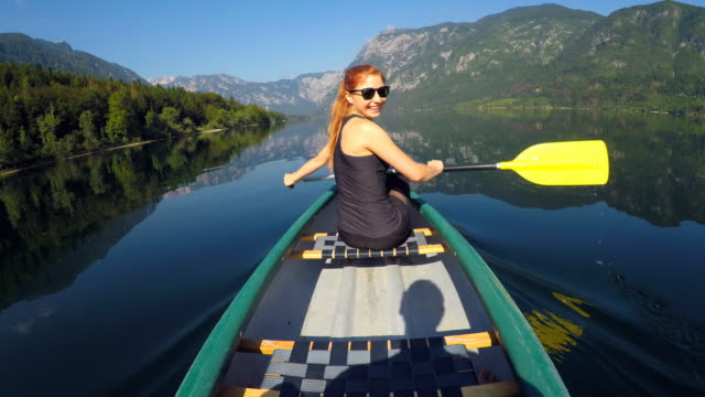 canoeing on a lake in summer - canoeing stock videos and b-roll footage