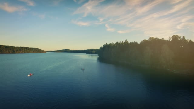 canoeing on a lake in sweden - lake stock videos & royalty-free footage