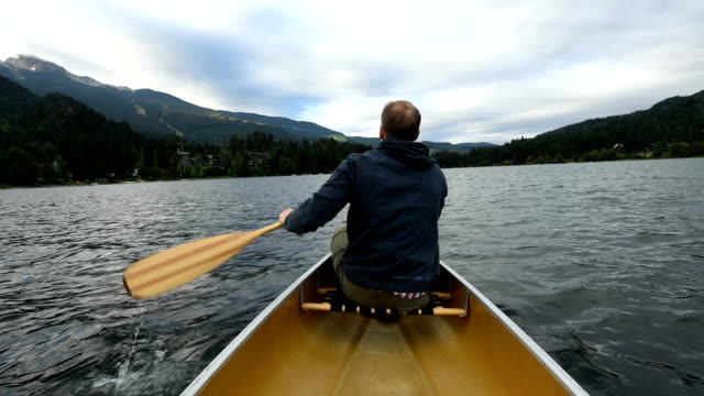 canoeing on alta lake in whistler, bc, canada - canadian culture stock videos and b-roll footage
