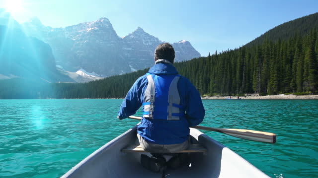 canoeing on mountain lake #2 - canoeing stock videos and b-roll footage