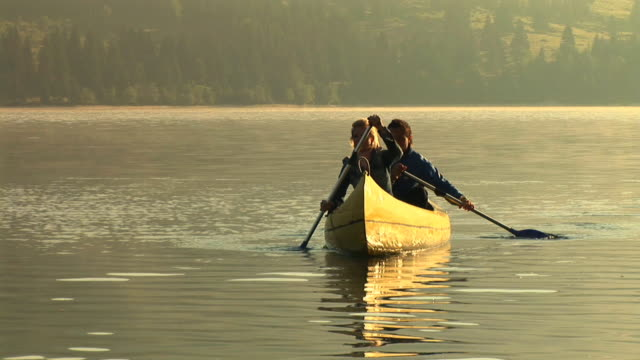 hd: canoeing on the lake - canoeing stock videos and b-roll footage