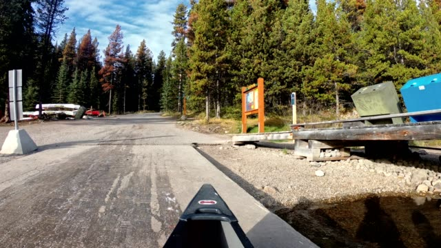 canoeing out of pier in autumn pine forest on sunny at maligne lake, jasper national park - nautical vessel stock videos & royalty-free footage