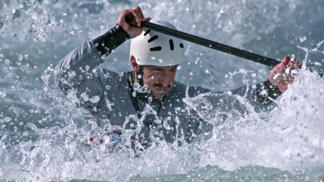 SLO MO Canoeist battling the whitewater course rapids