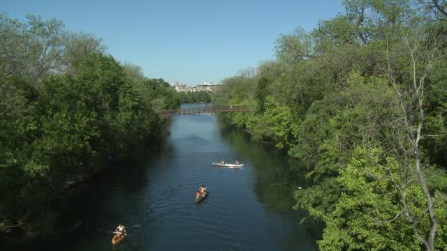 WS Canoeists paddling on Barton Creek in Zilker Park / Austin, Texas