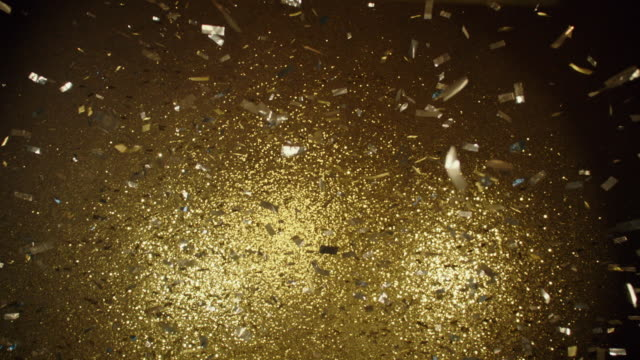 SLO MO Canons blow gold sequins