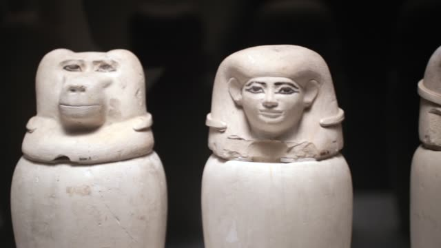 Canopic jars from Egypt which were used to bury mummified organs are displayed at the Field Museum on March 13 2018 in Chicago Illinois The artifacts...