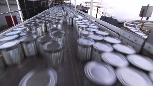 cans moving in opposite directions on production line - food processing plant stock videos & royalty-free footage