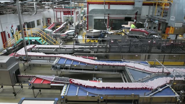 Cans of CocaCola Classic move along a conveyor at a CocaCola Amatil Ltd production facility in Melbourne Australia on Tuesday Feb 16 Unlabeled...