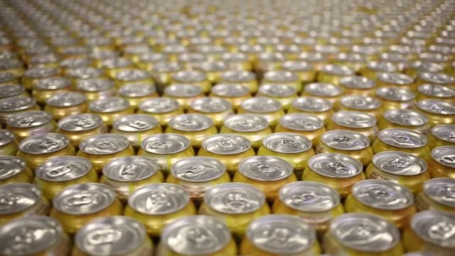 Cans of Country Time Lemonade move down a conveyor belt at the Dr Pepper Snapple Bottling Group plant in Louisville Kentucky US on Tuesday April 21...