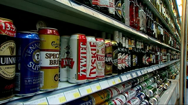 cans of lager on display in shop - lager stock videos & royalty-free footage