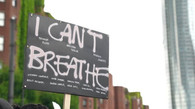 cant breathe banner is waved at black lives matter in london on june 7 2020 in london united kingdom the death of an africanamerican man george floyd... - i can't breathe stock videos & royalty-free footage