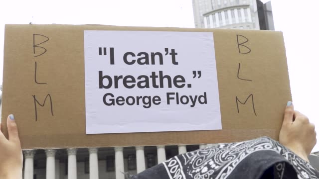 i can't breathe sign a predominantly teenage and college age crowd of demonstrators rallied at foley square and marched throughout downtown manhattan... - new age stock videos & royalty-free footage