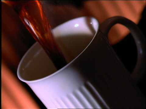 vídeos de stock e filmes b-roll de canted angle close up of coffee being poured into cup - 1997