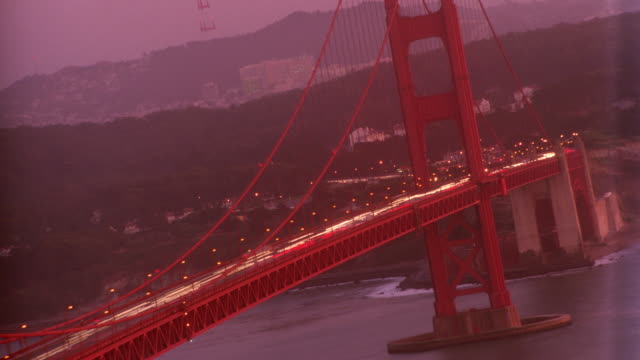 Canted time lapse traffic on Golden Gate Bridge / early evening / San Francisco
