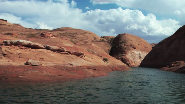a canyon river ripples near a rocky shore. - black canyon stock videos & royalty-free footage