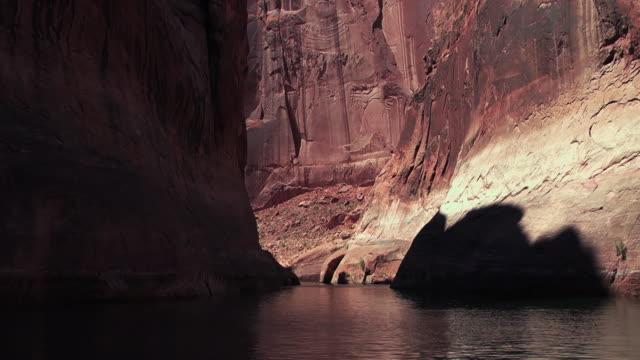 canyon walls narrow around a still river. - black canyon stock videos & royalty-free footage