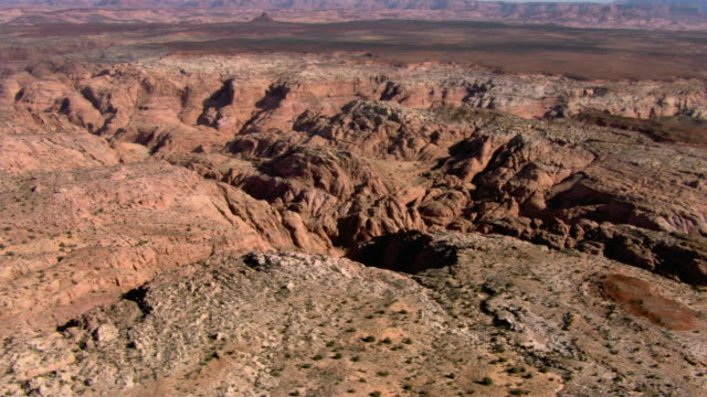 a canyon winds through the desert near page, arizona. - page arizona stock videos and b-roll footage