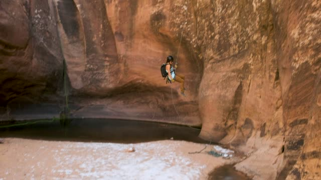canyoneering in moab, utah - abseiling stock videos & royalty-free footage
