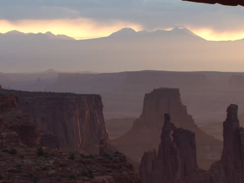canyonlands: weathered buttes beneath arch - weathered stock videos and b-roll footage