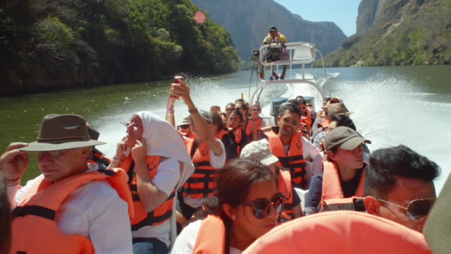 cañon del sumidero tour. tourist in a boat with lifejackets - life jacket stock videos & royalty-free footage