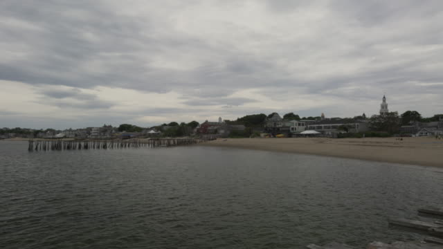 cape cod bay in provincetown day with pier and clouds. - ostamerika stock-videos und b-roll-filmmaterial