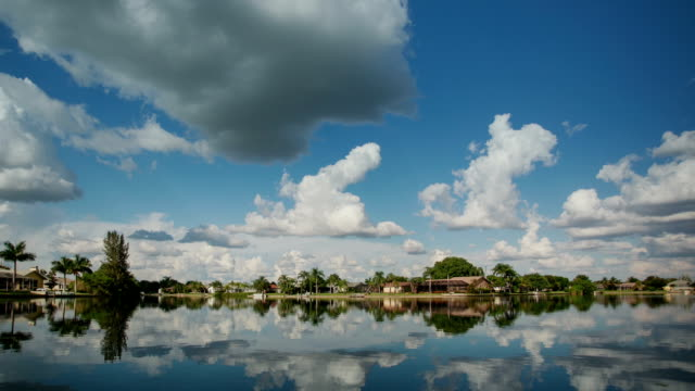 cape coral canals. clouds time lapse - cape coral stock videos & royalty-free footage