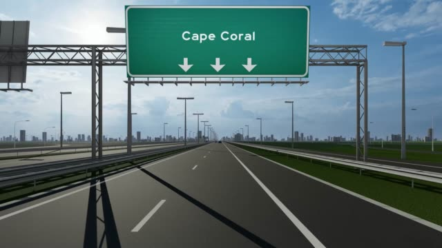 cape coral signboard on the highway stock video indicating the concept of entrance to usa city - cape coral stock videos & royalty-free footage