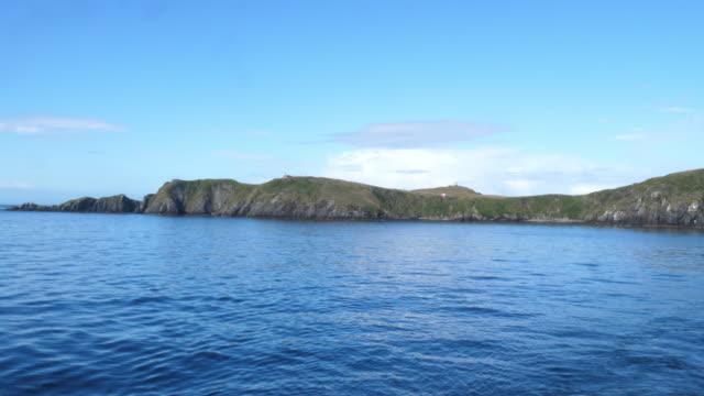 vídeos de stock, filmes e b-roll de cape horn island during summer - passear sem destino