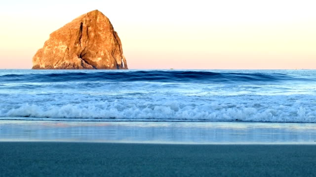 cape kiwanda sea stack similar to haystack rock wide and waves dawn oregon coast oregon 29 - stack rock stock videos and b-roll footage