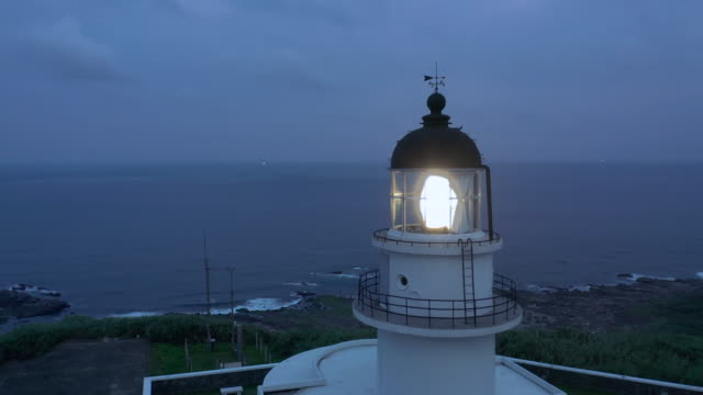 aerial ws cape santiago lighthouse at night - lookout tower stock videos & royalty-free footage