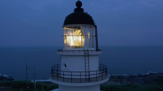 aerial ws cape santiago lighthouse at night - lighthouse stock videos & royalty-free footage
