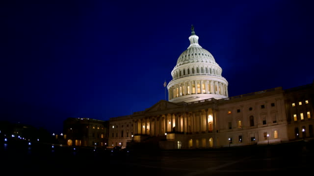 us capital after sunset with american flag - senate stock videos and b-roll footage