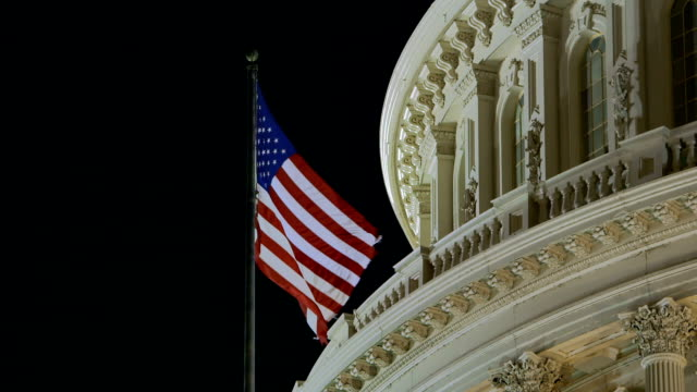 us capital after sunset with american flag - senator stock videos & royalty-free footage
