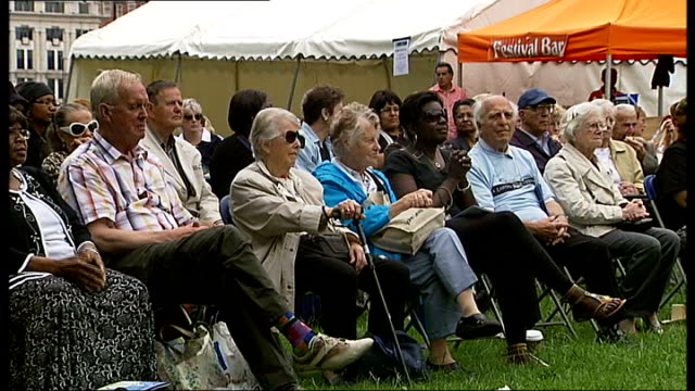stockvideo's en b-roll-footage met capital age festival 2011; england: london: south bank: ext people dancing on stage pull out back view of audience older people sitting in audience... - festivalganger