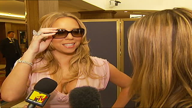 arrivals; england: london: capital radio: ext heidi range and keisha buchanan interview sot - singer, natalie imbruglia posing quickly for photocall... - autographing stock videos & royalty-free footage