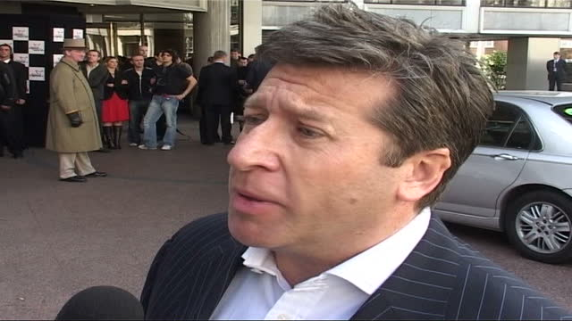 celebrity arrivals; england: london: lms neil fox posing for press zoom in, towards, speaking to press sot - zoom in stock videos & royalty-free footage