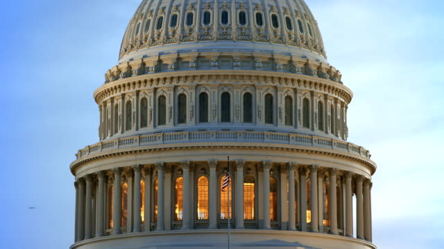 us capital dome at dusk with american flag - capital cities stock videos & royalty-free footage