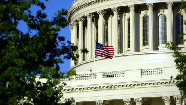 us capital medium angle with flag at half mast - senate stock videos & royalty-free footage