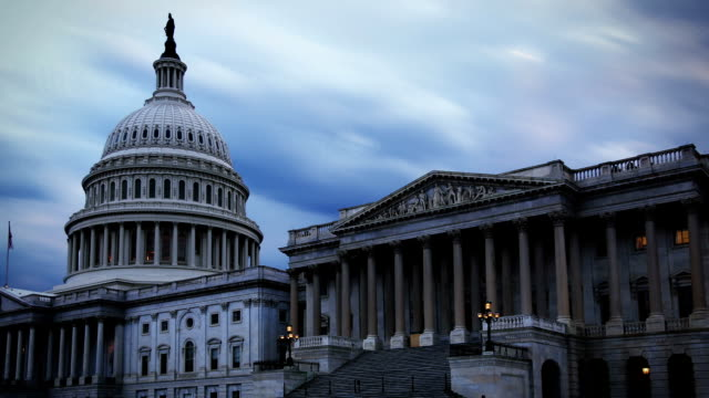 us capital time lapse with stormy skies - politics stock-videos und b-roll-filmmaterial