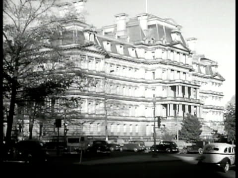capitol building behind park ws ext state department building sectary of state cordell hull sitting at desk sign over door division of the american... - cordell hull stock videos and b-roll footage