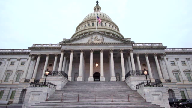 u.s. capitol building east facade with american flag in washington, dc - us republican party stock videos & royalty-free footage