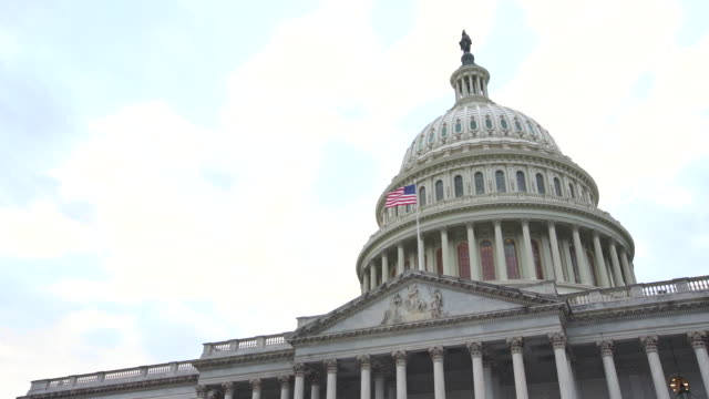 u.s. capitol building east facade with american flag in washington, dc - house of representatives stock videos & royalty-free footage