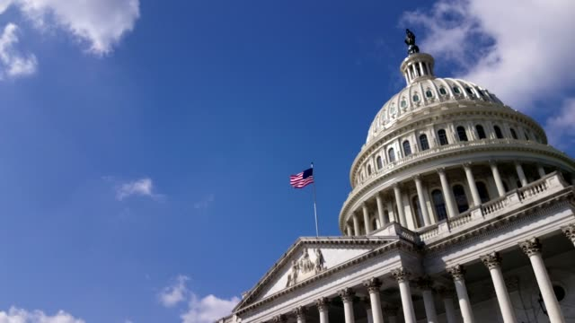 u.s. capitol building east facade with american flag in washington, dc - government building stock videos & royalty-free footage