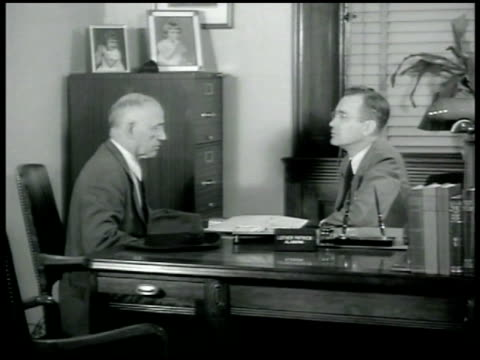 vidéos et rushes de alabama congressman luther patrick talking w/ man at desk saying all he has to do is pick out which job he would like thinking about sending home for... - 1942