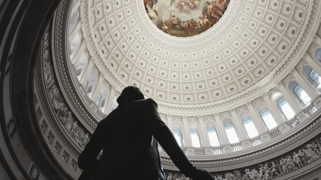 u.s. capitol building rotunda george washington in washington, dc - tilt up - rotunda stock videos & royalty-free footage