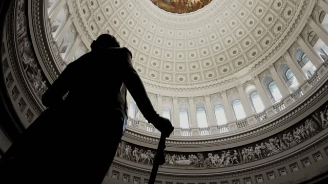 u.s. capitol building rotunda george washington in washington, dc - tilt up - washington dc stock videos & royalty-free footage