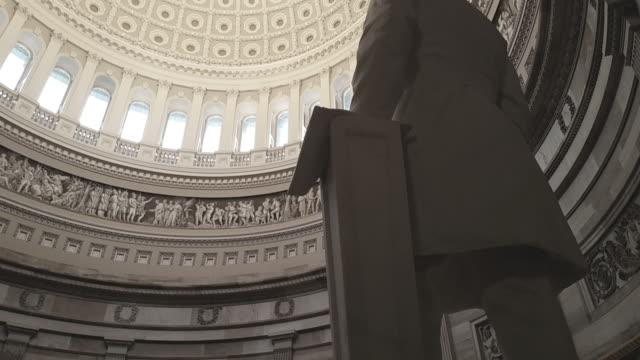 u.s. capitol building rotunda james a. garfield tilt up in washington, dc - rotunda stock videos & royalty-free footage